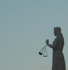Scales of Justice by mikecogh via Flickr