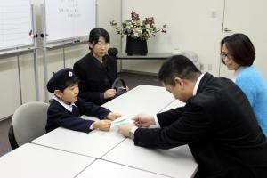 Shoichi Kondoh presents donation for Typhoon Yolanda relief at the Philippine Embassy in Tokyo.