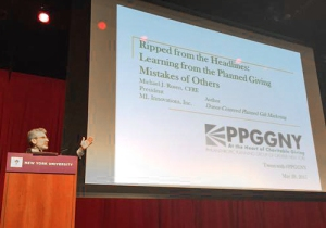 Michael Rosen at PPGGNY Conference, starting at the podium before speaking from the audience during his keynote address.