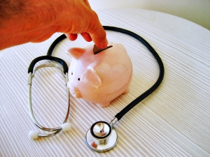 Stethoscope and Piggy Bank via 401(K) 2012 via Flickr