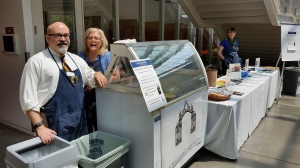 Sam Samuels, Christine Carr Hill, and Jeanette Wintjen staff the Smith College ice-cream stand during Reunion Weekend.