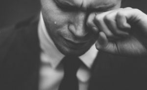Crying Man by Tom Pumford via Unsplash